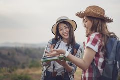 Two woman searching direction on location map while traveling stock image