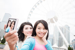 Two woman selfie in hongkong. Two beauty women smile happily and selfie in hongkong stock images