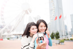 Two woman selfie in hongkong. Two beauty women thumb up and selfie in hongkong royalty free stock photo