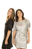 Two woman shiny dresses smiling Royalty Free Stock Photo