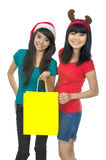 Two Woman Shopping For Christmas Royalty Free Stock Photo