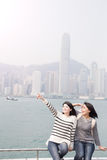 Two woman show something. Two beauty women show something to you in hongkong Stock Photography