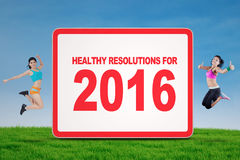 Two Woman Showing Healthy Resolution for 2016 Stock Photography