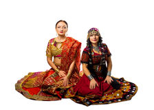 Two woman sit in traditional indian costume Stock Images