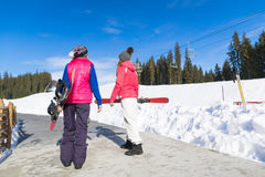 Two Woman Ski And Snowboard Resort Winter Snow Mountain Girls Holiday Royalty Free Stock Images