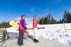 Two Woman Ski And Snowboard Resort Winter Snow Mountain Girls Holiday Royalty Free Stock Photography