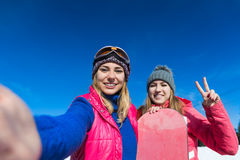 Two Woman Ski And Snowboard Resort Winter Snow Mountain Girls Taking Selfie Photo Smart Phone Stock Photography