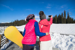 Two Woman Ski And Snowboard Resort Winter Snow Mountain Girls Taking Selfie Photo Smart Phone. Holiday Extreme Sport Vacation Royalty Free Stock Images