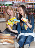 Two woman smailing in supermarket Royalty Free Stock Image