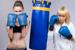 Two woman in sports is a boxing Royalty Free Stock Photos