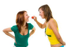 Two woman with strawberry Stock Photos