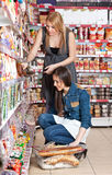 Two woman in supermarket Royalty Free Stock Image