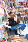 Two woman in supermarket Royalty Free Stock Images