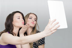 Two woman and tablet Royalty Free Stock Photo