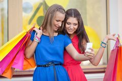 Two woman taking pictures of themselves Royalty Free Stock Image