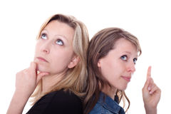 Two woman are thinking Stock Images