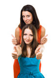 Two woman with thumb up,in colorfull dresses Stock Photography
