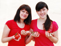 Two woman with tomatoes Stock Images