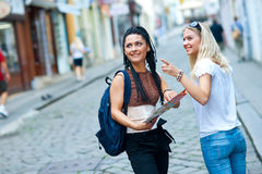 Two woman tourists in the city Royalty Free Stock Photos