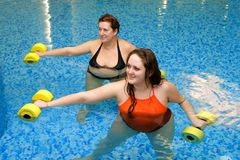 Two woman training in water Stock Images