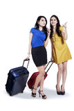 Two woman traveling with suitcase Stock Image