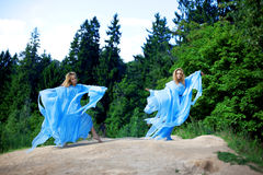 Two woman, twins in the forest Royalty Free Stock Photo