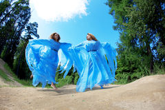 Two woman, twins in the forest Royalty Free Stock Photography