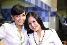 Two woman with uniform. Smiling Royalty Free Stock Photos