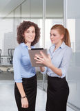 Two woman using tablet Stock Photos