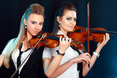 Two woman with violin Royalty Free Stock Photo