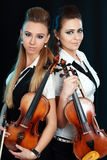 Two woman with violin Royalty Free Stock Images