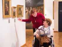 Two woman whatching art works Stock Photo