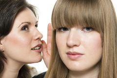 Two woman whisper Stock Images