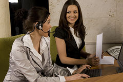 Two woman working Stock Image