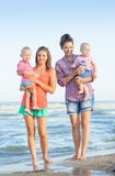 Two Womans with children on the beach Stock Photo