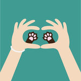Two womans hands holding cute cat dog paw print. Love and care pet animals. Helping hand concept. Adopt, donate. Flat design.. Green background. Template Royalty Free Stock Image