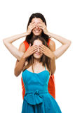 Two womans play with their hands in color dresses Stock Image