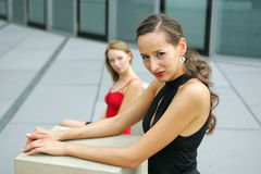 Two women. A Shot of two women posing on the street stock photo
