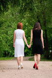 Two women. Two young women are going away Royalty Free Stock Photo