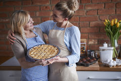 Two women with apple cake Royalty Free Stock Images