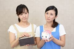 Women with money. Two women in apron with money Stock Image