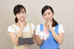 Women with money. Two women in apron with money Royalty Free Stock Photos