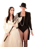 Two women as bride and groom with axe Stock Image
