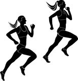 Two women athletes runners. Running competition black silhouettes Stock Photography