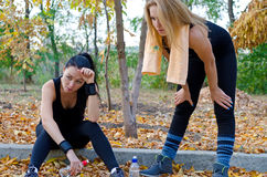 Two women athletes taking a break Stock Photography