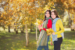 Two women in autumn park Royalty Free Stock Images