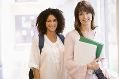 Two women with backpacks standing stock photos