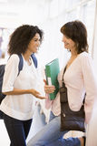 Two women with backpacks standing Stock Photo