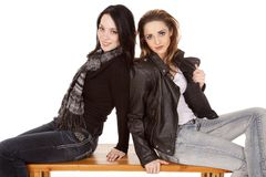 Two women backs together smile Royalty Free Stock Photography