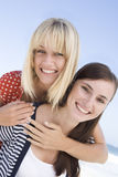 Two women on beach holiday Stock Images